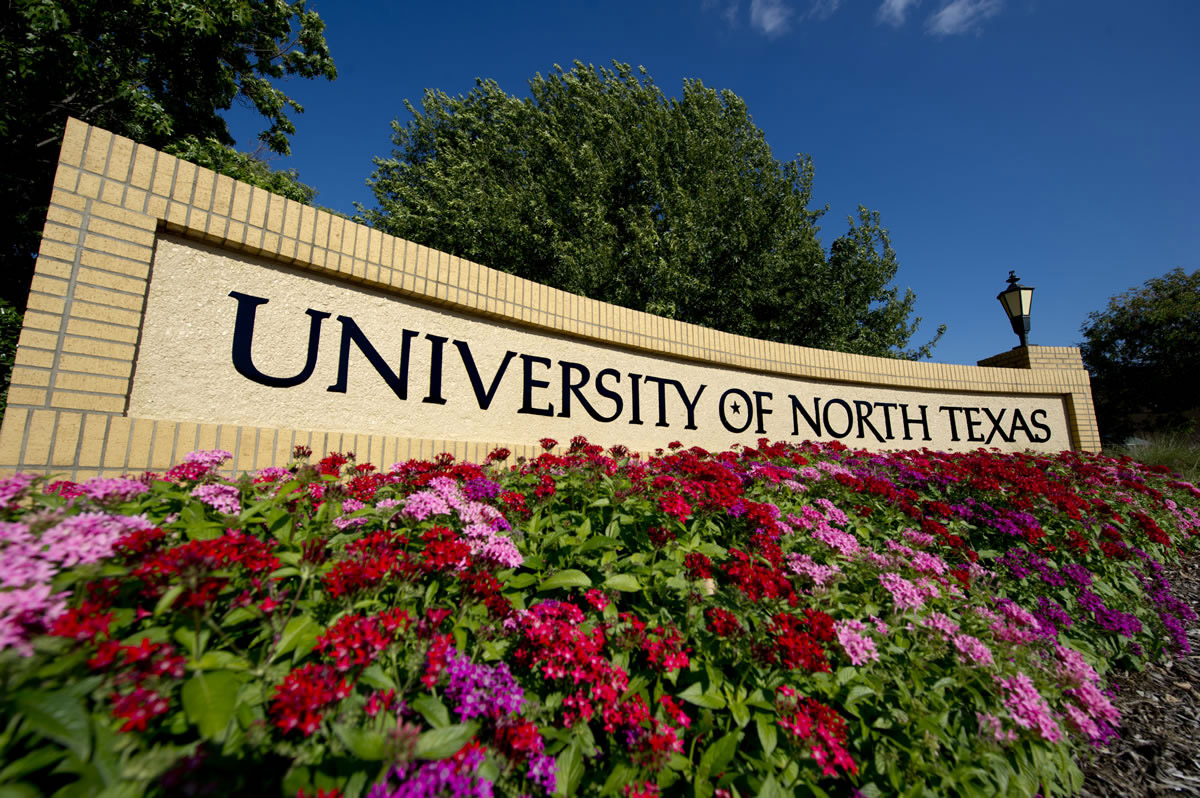 University of North Texas sign with flowers